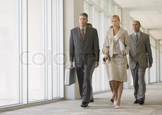 ©Frédéric Cirou/AltoPress/Maxppp ; Executives walking through corridor of office building