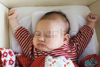 Image of 'baby, sleeping, pillow'