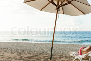 Image of 'naked, beach, deck chairs'