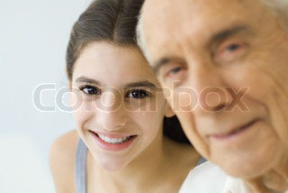 ©Eric Audras/AltoPress/Maxppp ; Teen girl looking over grandfather's shoulder, both smiling, focus on background