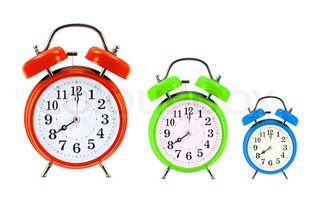 classic red, green and blue alarm clocks isolated on white background