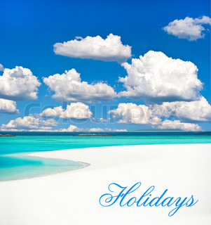 tropical sand beach over cloudy blue sky. holiday background.