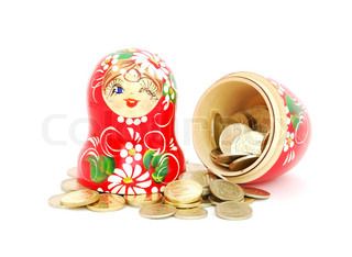 An opened russian nesting doll with russian rubles coins on white background