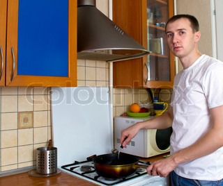 adult man cooking at the kitchen alone