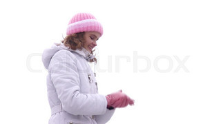 Woman making snow ball and throwing.