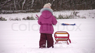children with sleds