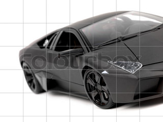 A Model Sports Car Isolated Against A White Background