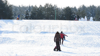 family with sleds on winter hill, time lapse