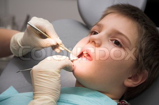 young boy at the dentist's clinic