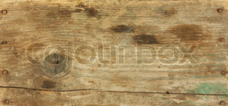 background of the old piece of wood with nails