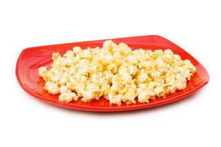 Popcorn on red plate isolated on white