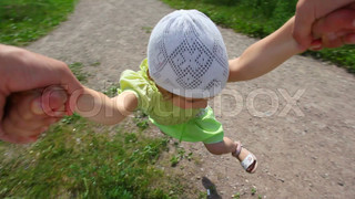 first person view from man rotates little girl in park