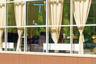 view from the street through a window at the interior of the cafe