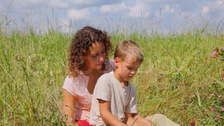 mother with son talking in the field
