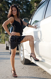 young beauty girl with car on the road