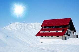 Lonely house in bright sunny winter day