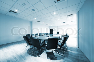 a large table and chairs in a modern conference room