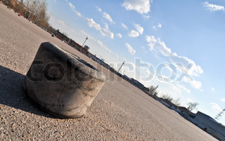 old karting tire on the asphalt of a race track