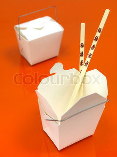 A Chinese takeaway container isolated against an orange background