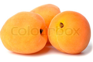 Three ripe, juicy apricots on a white background.
