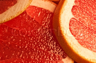 Parts of a  red grapefruit extreem close up