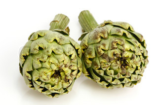 Two fresh artichokes over white background
