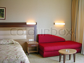 Modern bedroom interior with red sofa