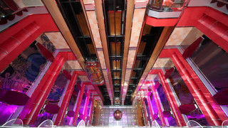 elevators in multilevel interior of cruise ship, in Persian Gulf.