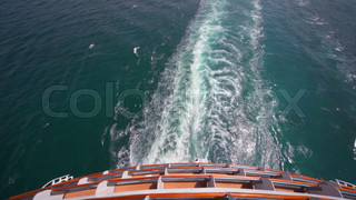 trace on water, view from top deck of cruise ship in sea
