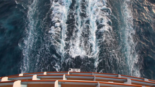 trace on water, view from top deck of cruise ship