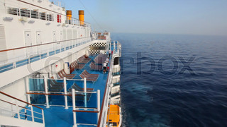 workers cleans deck of cruise ship