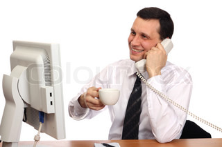 Smiling businessman talking on the phone with a cup in his hand on a white background