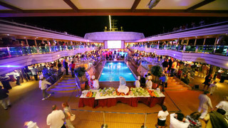 big party around swimming pool on Costa Deliziosa - the newest Costa cruise ship.