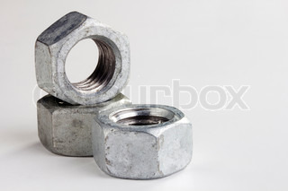 Silver metallic nuts isolated on a white background. Add your text to the background.