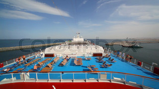 people on top deck of cruise ship