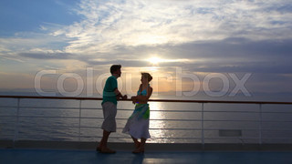couple stands on ship moving in sea