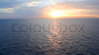 waving sea during sunset, view from moving ship