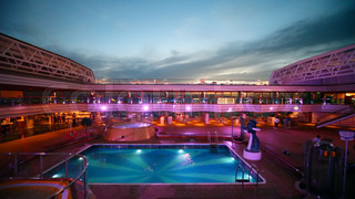 swimming pool on top deck of cruise ship