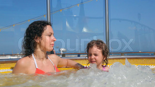 mother and daughter in hot whirlpool on deck of ship