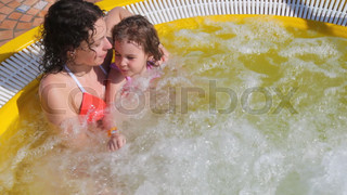 woman and girl in hot whirlpool on deck of ship