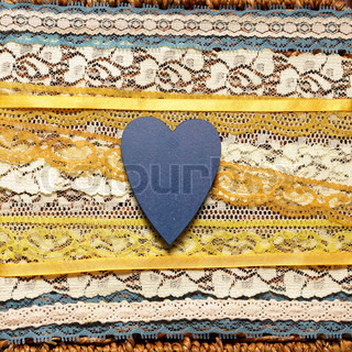 romantic background with blue hearts and yellow ribbons