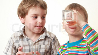 boy and little girl drink juice