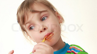 little girl licking lollipop in chicken form