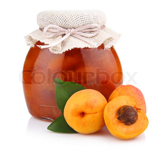 Apricot jam isolated on white background