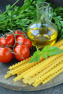 cherry tomatoes on a branch, basil, pasta and olive oil