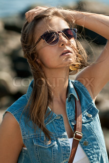 portrait of a beautiful girl in the wind in sunglasses