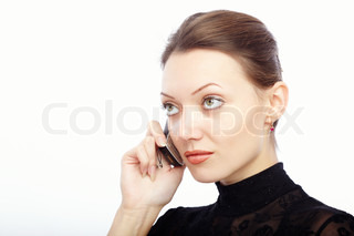 Serious lady on a white background talking via cellphone