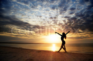 Moving healthy lady at the beach during sunset