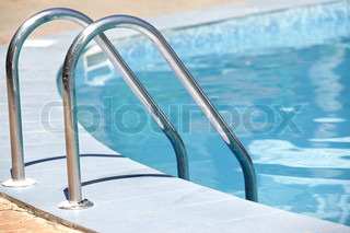 Handrail of the public swimming pool. Horizontal photo