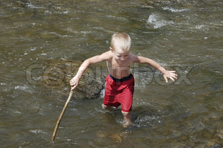 The boy passing the river in ford